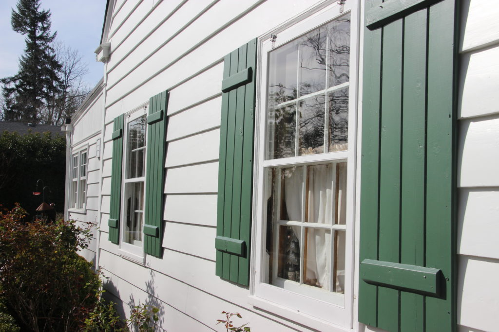 Wood Storm Sash with dark shutters